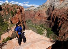 Hiking in Zion. Woman hiking Angels Landing in Zion National Park Royalty Free Stock Images