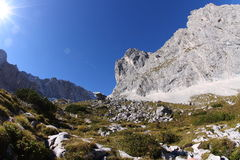 Hiking Zugspitze. Hiking trail to the top of Zugspitze, Germany's highest mountain, with Zugspitze in the background. Shot with a fish eye Royalty Free Stock Image