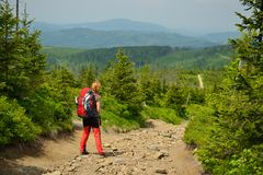Treking in the mountains with the backpack in Poland. Hikings along tourist trails in the mountains Beskid in Poland with the backpack on the back Royalty Free Stock Images