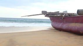 HIKKADUWA, SRI LANKA - FEBRUARY 2014: Boat on Hikkaduwa beach while waves are splashing. Hikkaduwa is famous for its beautiful bea stock footage