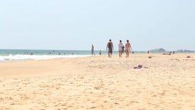 HIKKADUWA, SRI LANKA - FEBRUARY 2014: View of Hikkaduwa beach while waves are splashing and people are enjoying themselves in the  stock video
