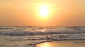 HIKKADUWA, SRI LANKA - FEBRUARY 2014: The view of the ocean waves on Hikkaduwa beach at sunset. Hikkaduwa is famous for its beauti. Ful beaches stock video