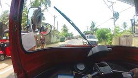 HIKKADUWA, SRI LANKA - MARCH 2014: Slow motion sequence of view from tuktuk on the amazing streets of Hikkaduwa. stock video footage