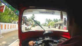 HIKKADUWA, SRI LANKA - MARCH 2014: Slow motion sequence of view from tuktuk on the amazing streets of Hikkaduwa. stock footage