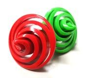 Hilanderos rojos y verdes en un fondo blanco Imagen de archivo libre de regalías