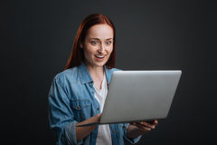 Hilarious attractive girl excited about received email Royalty Free Stock Photos