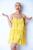 Hilarious blond woman posing over white Stock Photos