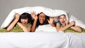 Hilarious laughter fun at teenage slumber party Royalty Free Stock Photo