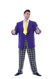 Hilarious man in colorful costume posing thumbs up Royalty Free Stock Photos