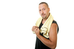 Hilarious man with a towel after exercise Royalty Free Stock Images