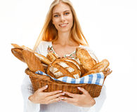 Hilarious woman with bread and rolls Royalty Free Stock Images