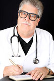 Hilariously funny medical doctor huge eyes writing Royalty Free Stock Photos