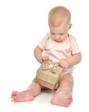 Сhild baby toddler kid with small rustic  hand made present gif Stock Image