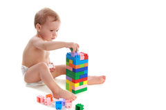 �hild builds the house of the cubes Royalty Free Stock Images