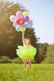 Сhild with a bunch of balloons in their hands Royalty Free Stock Photography