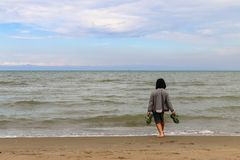 Сhild on the edge of the sea, Italy, Riccione stock photos