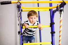 Сhild on a ladder. A child in a baby ladder Stock Image