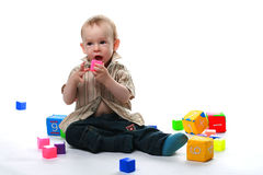 Сhild plays bricks Stock Photo