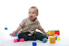 Сhild plays bricks. Baby plays cubes on a white background Stock Photo