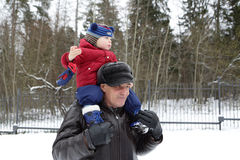 �hild on shoulders of his grandfather Stock Image