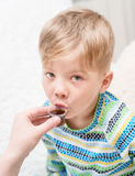 Сhild taking cough syrup Royalty Free Stock Image