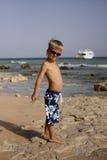 Сhild walks on the seashore Royalty Free Stock Image