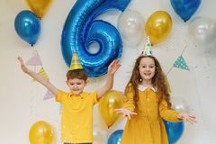Hildren with balloons at happy birthday party. royalty free stock images