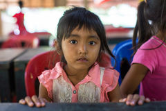 Сhildren in the classroom at lunch time at school by project Cambodian Kids Care. KOH CHANG, THAILAND - FEB 8, 2016: Unidentified children in the classroom at Stock Photography
