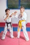 ?hildren demonstrate martial arts working together Stock Images