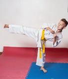 ?hildren demonstrate martial arts working together Stock Photos