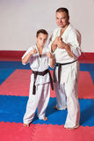 ?hildren demonstrate martial arts working together Royalty Free Stock Photos