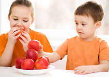Сhildren eating red apple Royalty Free Stock Photo