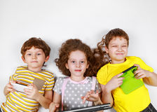 Сhildren friend playing in smartphone and notebooks Stock Image