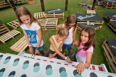 Сhildren play piano outdoor Royalty Free Stock Photo