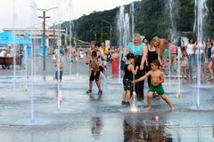 Сhildren playing in the fountain. Royalty Free Stock Image
