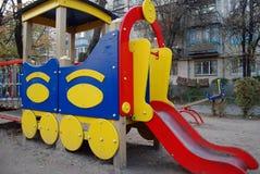 Ð¡hildren's playground. On the playground. Ð¡hildren's slide. Locomotive royalty free stock photography