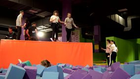 Hildren and young people jumping on trampoline, sport activities for kids and elders, having fun on trampoline at local