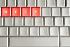Hilfe buchstabiert auf einer Tastatur stockfotos