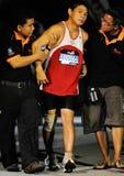 Hilfe für ultramarathon nach dem Ende Stockfotos