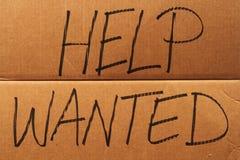 Hilfe wünschte Pappzeichen Lizenzfreie Stockfotografie