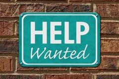 Hilfe wünschte Zeichen auf einem Backsteinbau Lizenzfreies Stockbild