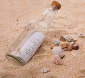 HILFENmitteilung in einer Flasche II Stockbild