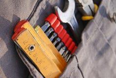 Hilfsmittel in der Tasche Stockfotos