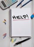 Hilfswort auf Papier Lizenzfreies Stockbild
