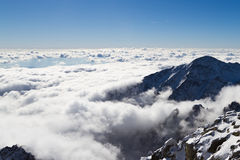 On the hill above the clouds. Panorama view from Lomnicky Peak, High Tatras, Slovakia Stock Image
