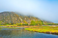 The hill in advection fog and yalu river Stock Photos