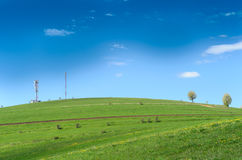 Hill with antennas and blue sky. Trees royalty free stock photo