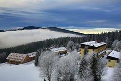 Hill, Arber (Germany), Cloudes and trees, winter landscape in Šumava in Železná Ruda, czech republic Stock Image