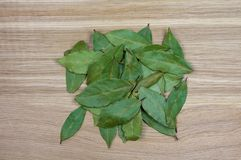A hill of bay leaves on the oak cutting board, close-up stock photography