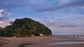 Hill on the beach. SABAH, MALAYSIA - JULY 6, 2017 :The majestic view of small hill on `Pantai Manis` beach Royalty Free Stock Photo